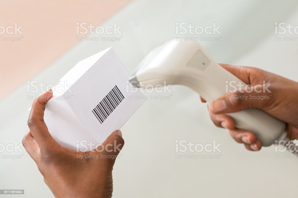 Person's Hand Scanning Barcode With Barcode Scanner stock photo