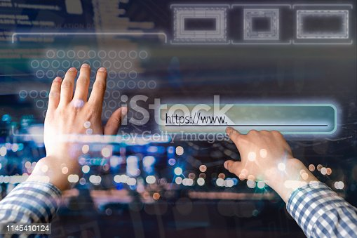 istock persons hand touch virtual adress bar b 1145410124