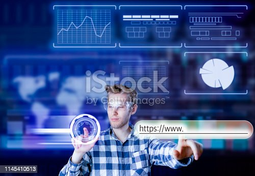 istock persons hand touch virtual adress bar b 1145410513