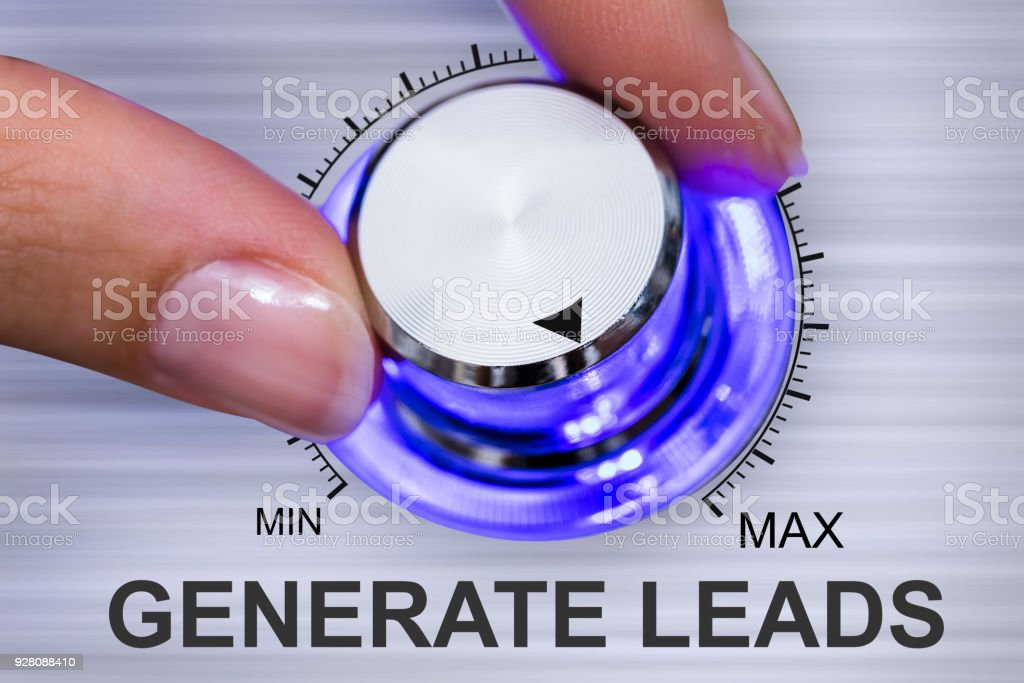 Person's Hand Turning Generate Leads stock photo