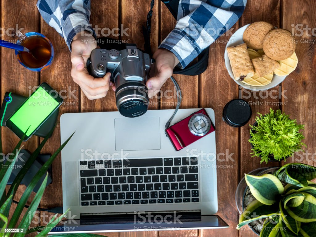Persons Hands With Photo Camera Working At New Photoes Stock Of Digital Cameras Royalty Free