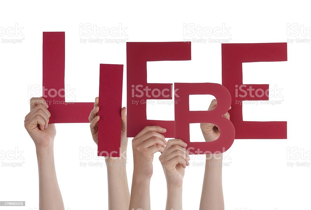Persons Holding Liebe royalty-free stock photo