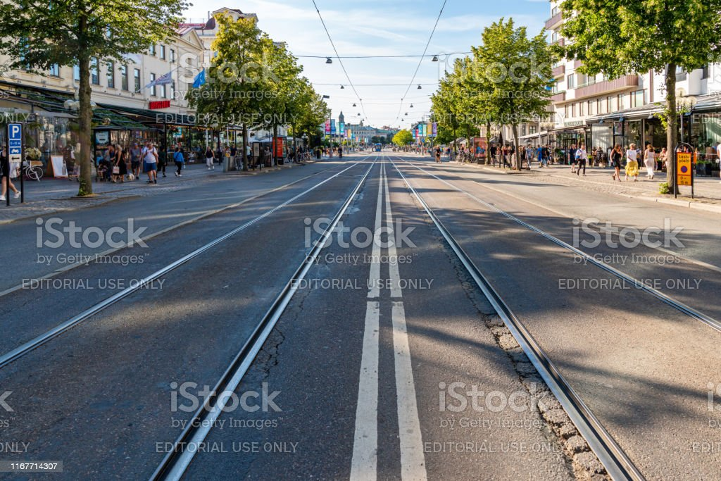 Perspective city street view of main street Avenyn with tram rails...