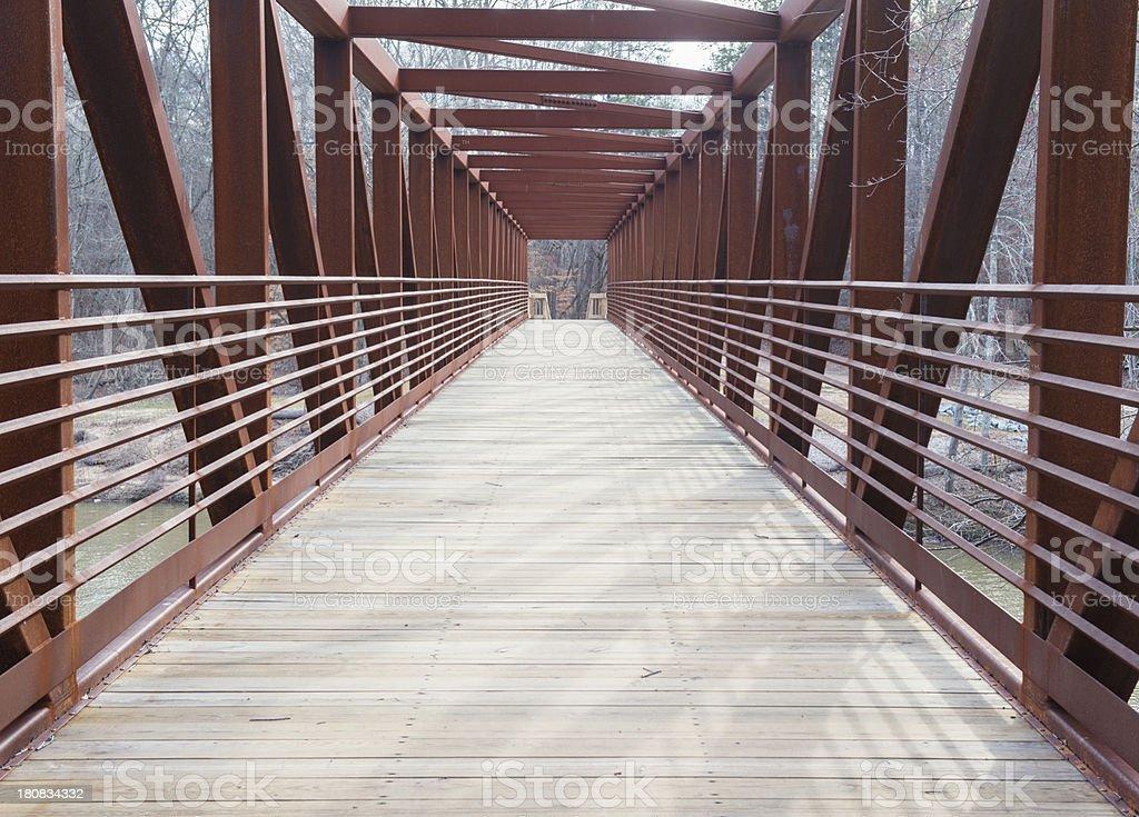 Perspective Inside Metal Pedestrian Bridge stock photo
