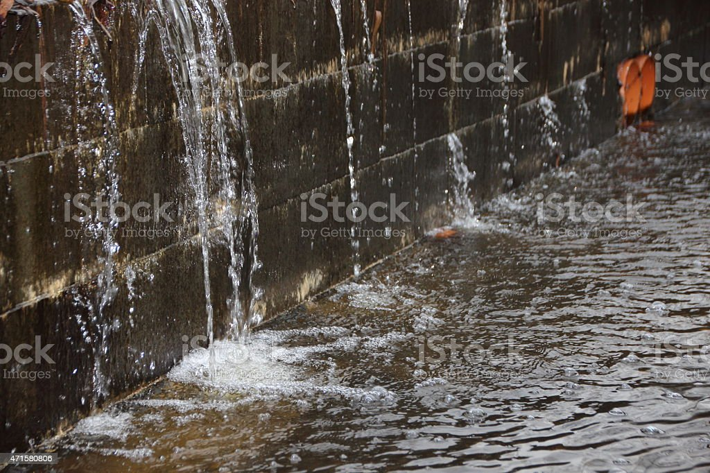 Perspective of Embankment under Pressure with Water Spraying stock photo
