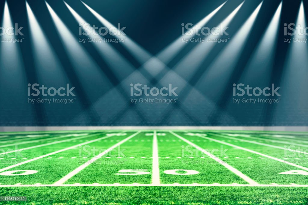 Football stadium with white lines marking the pitch. Perspective of...