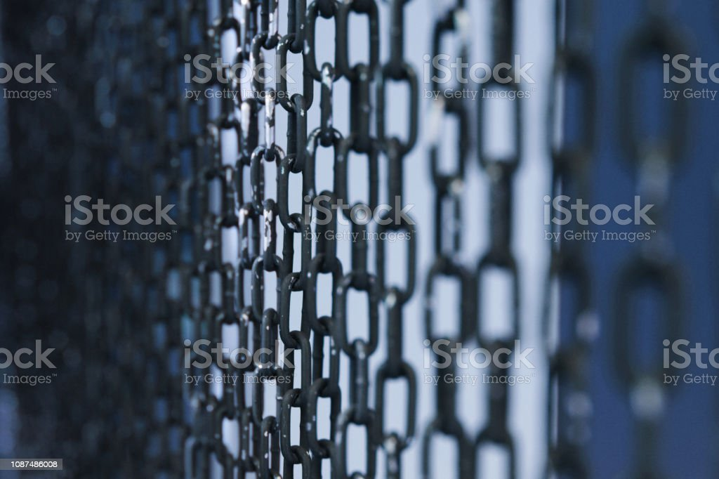 Perspective of metal chains curtain background. Selected focus. stock photo