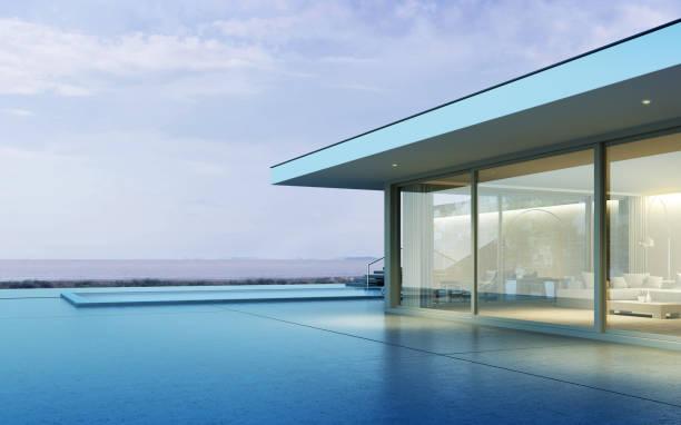perspektive eines modernen gebäudes mit holzterrasse und pool auf meerblick hintergrund, idee der familienurlaub. 3d-rendering. - küstenfamilienzimmer stock-fotos und bilder