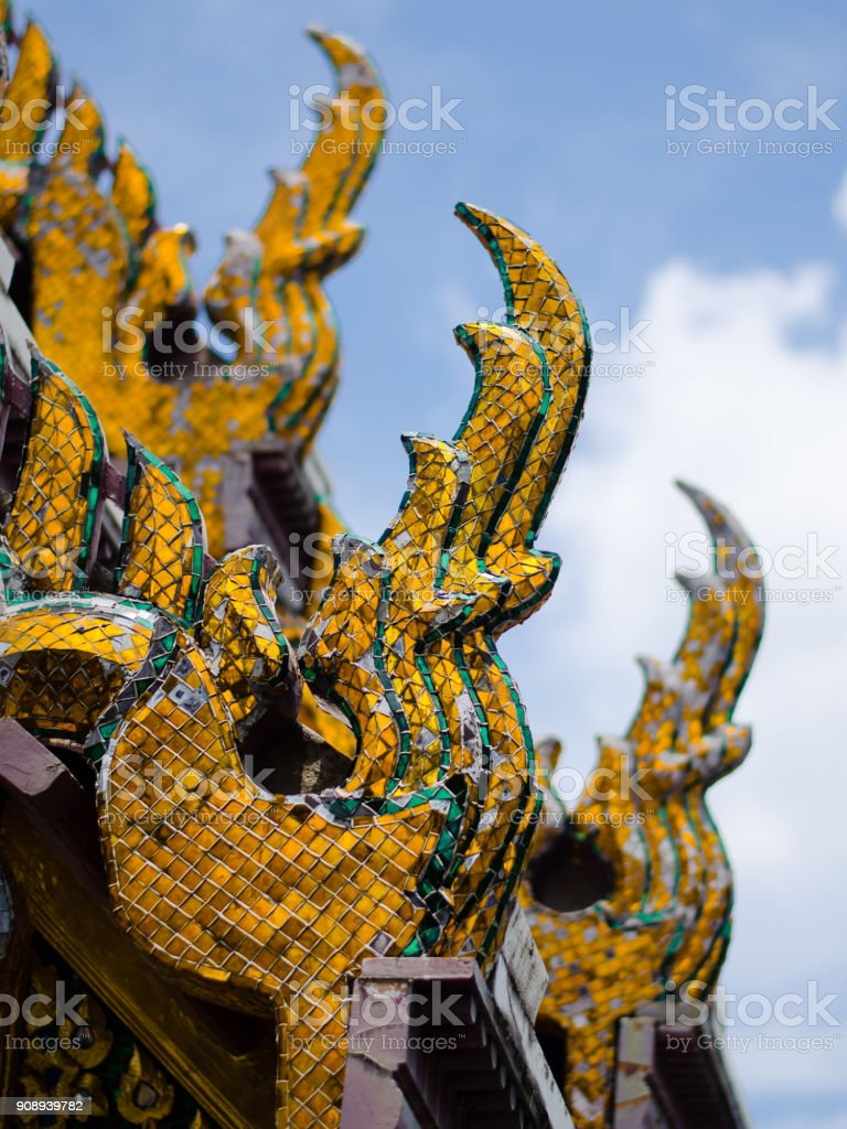 Perspective of Naga figures on a Thai temple roof for decoration. stock photo