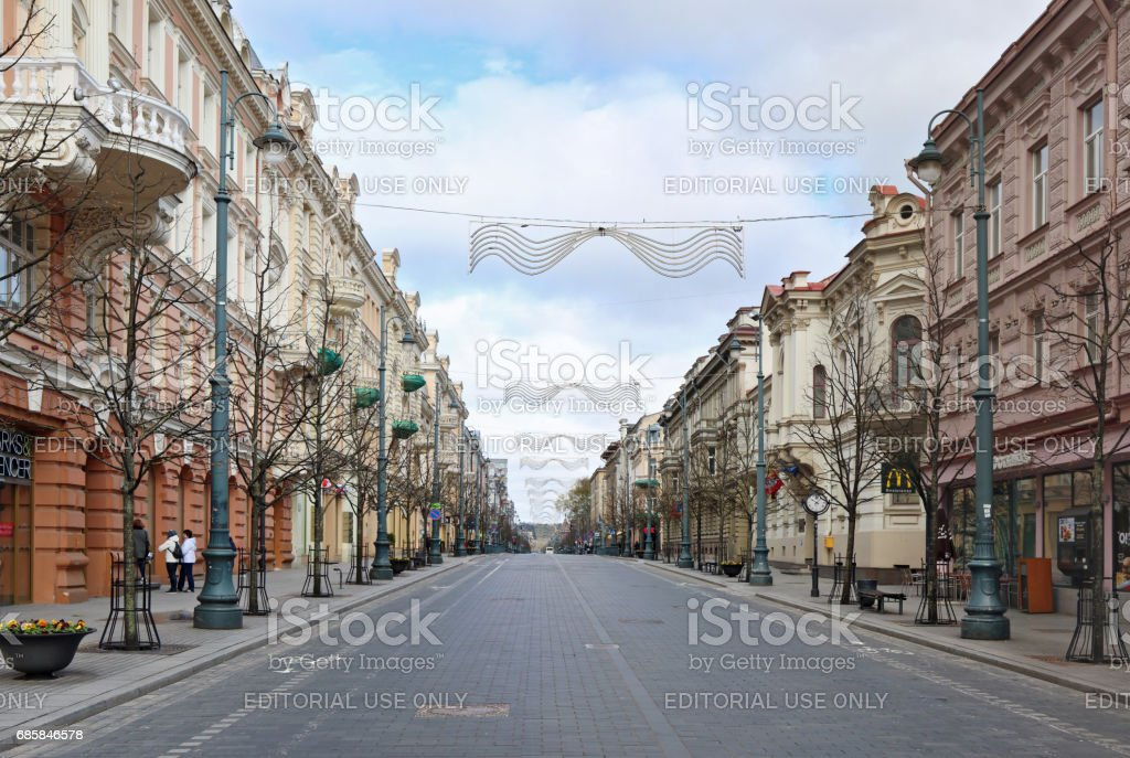 VILNIUS, LITHUANIA -APRIL 30, 2017: Perspective  of the main central spring street of the Lithuanian capital - Gediminas Avenue. Sunday April morning, isn't enough people and cars stock photo