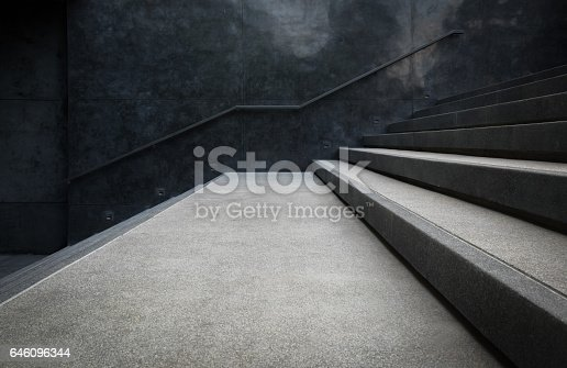 Perspective of the staircase and railing on concrete or marble walls for background.