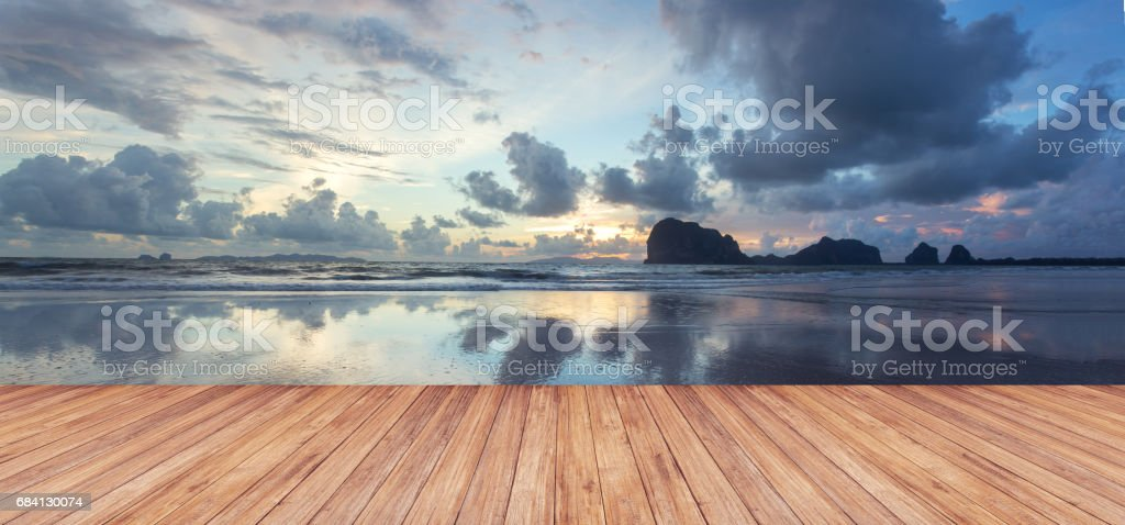 Perspective of wood terrace against beautiful seascape at sunset stock photo