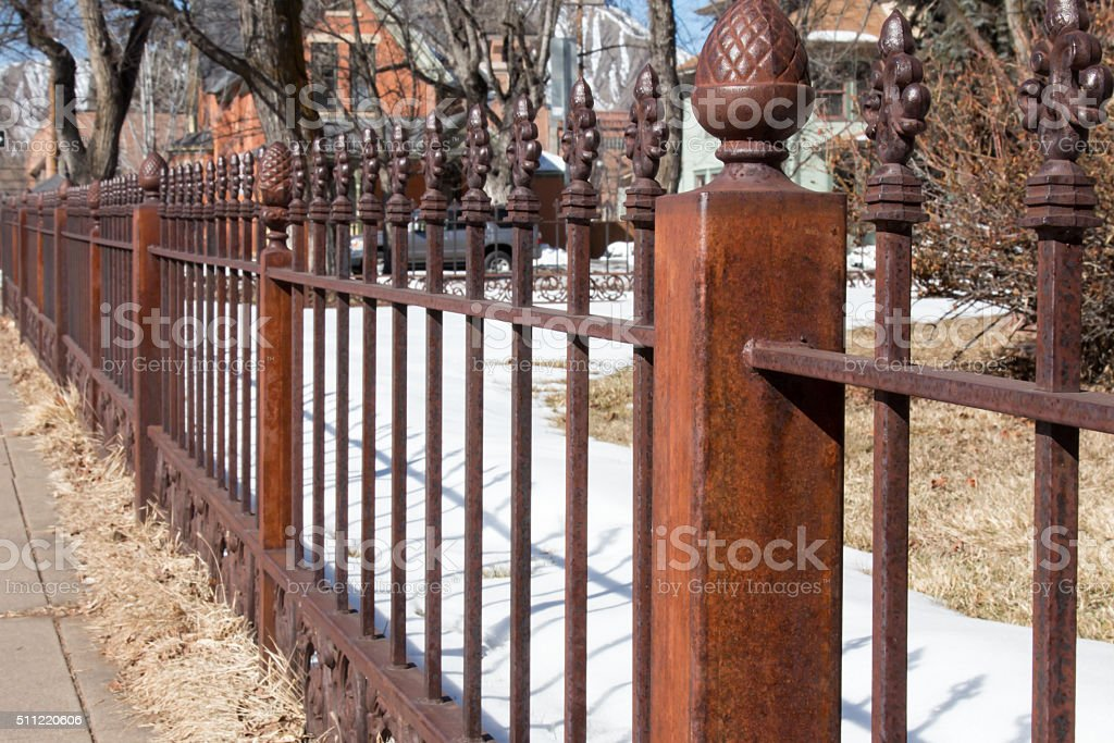 Perspective On A Rusted Wrought Iron Fence In The
