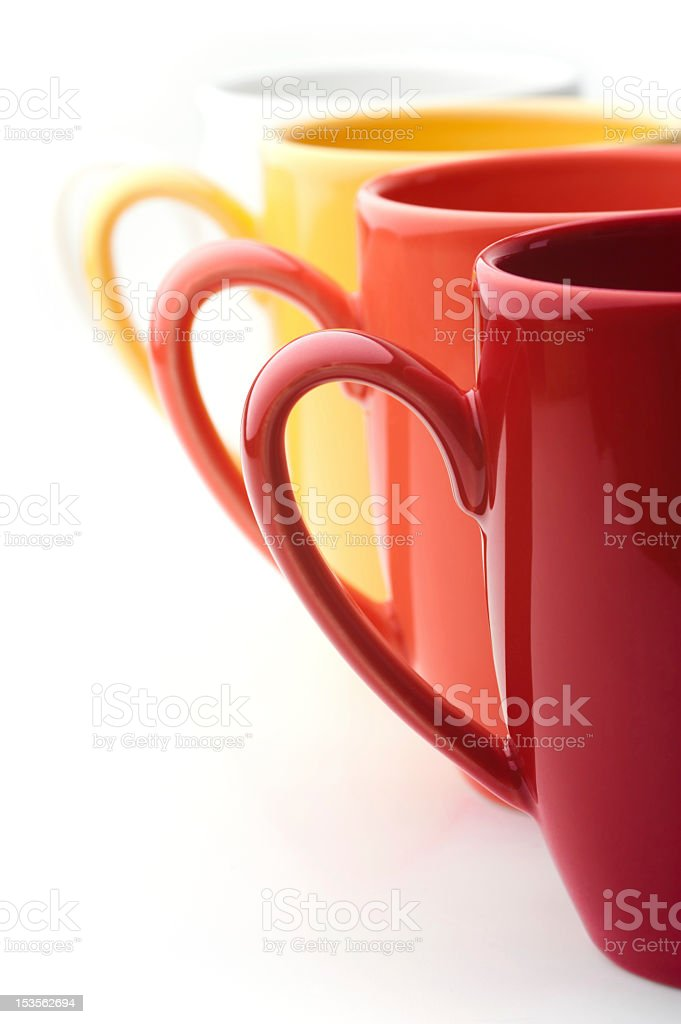 Perspective row of bright colorful mugs, red, orange, yellow and stock photo