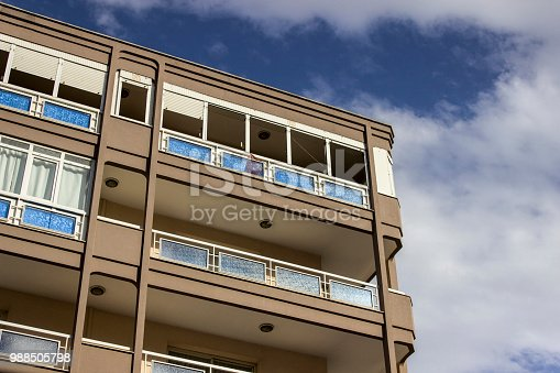 Perspective shot of urban reinforced constructed modern building with blue sky in Izmir at Turkey in summertime