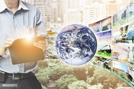 istock Perspective stock market index information shown growth in real estate data of global business success background.Image of earth furnished by NASA. 966303072