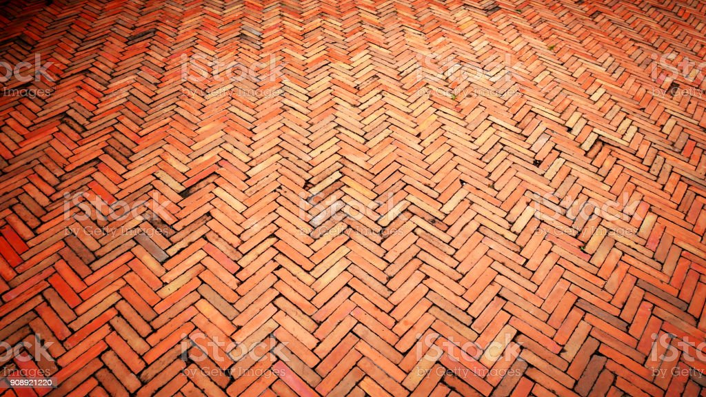 Perspective Texture Background of Tiled Floor with Zigzag Pattern stock photo