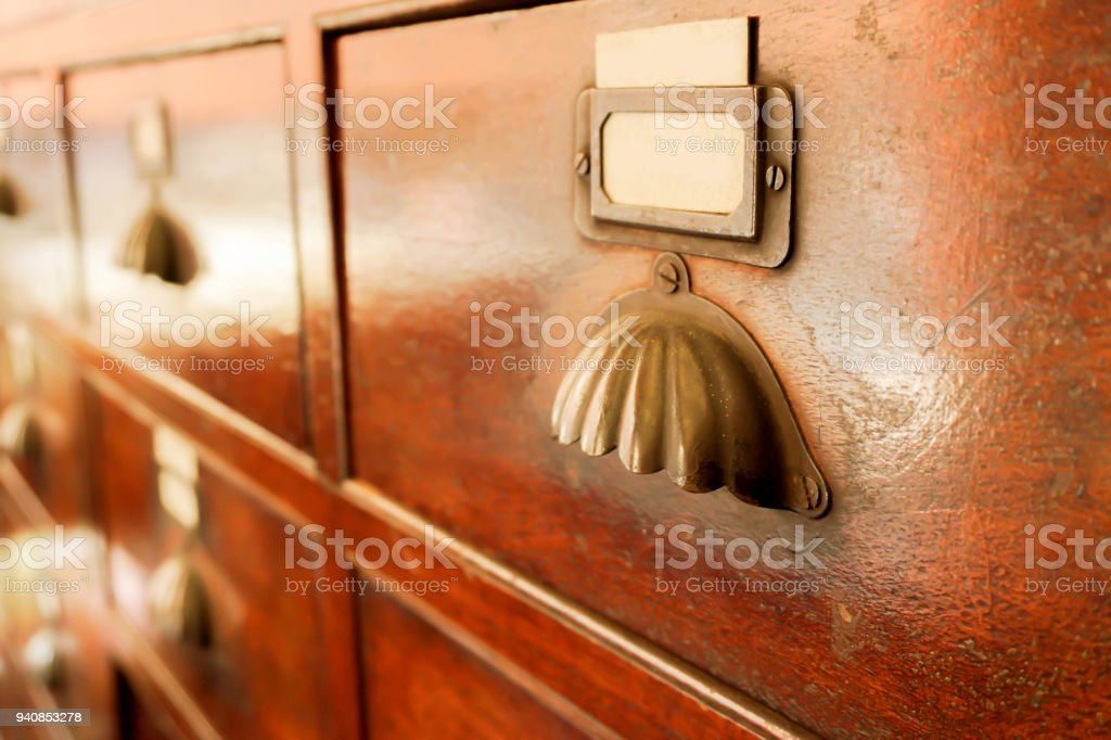 Perspective view and closeup of ancient wooden drawer i stock photo
