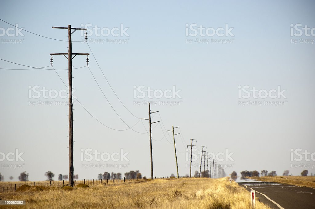 Perspective view electric poles and straight country road. royalty-free stock photo