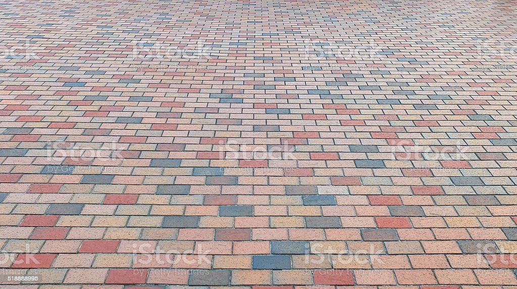 Perspective View of Colorful Brick Stone Street Road. Sidewalk stock photo