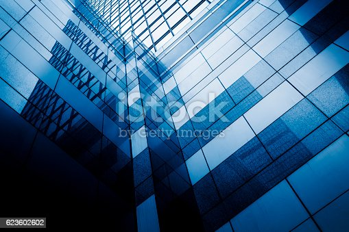 istock Perspective view of contemporary glass building skyscraper 623602602