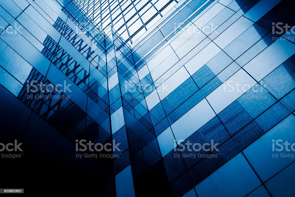 Perspective view of contemporary glass building skyscraper stock photo