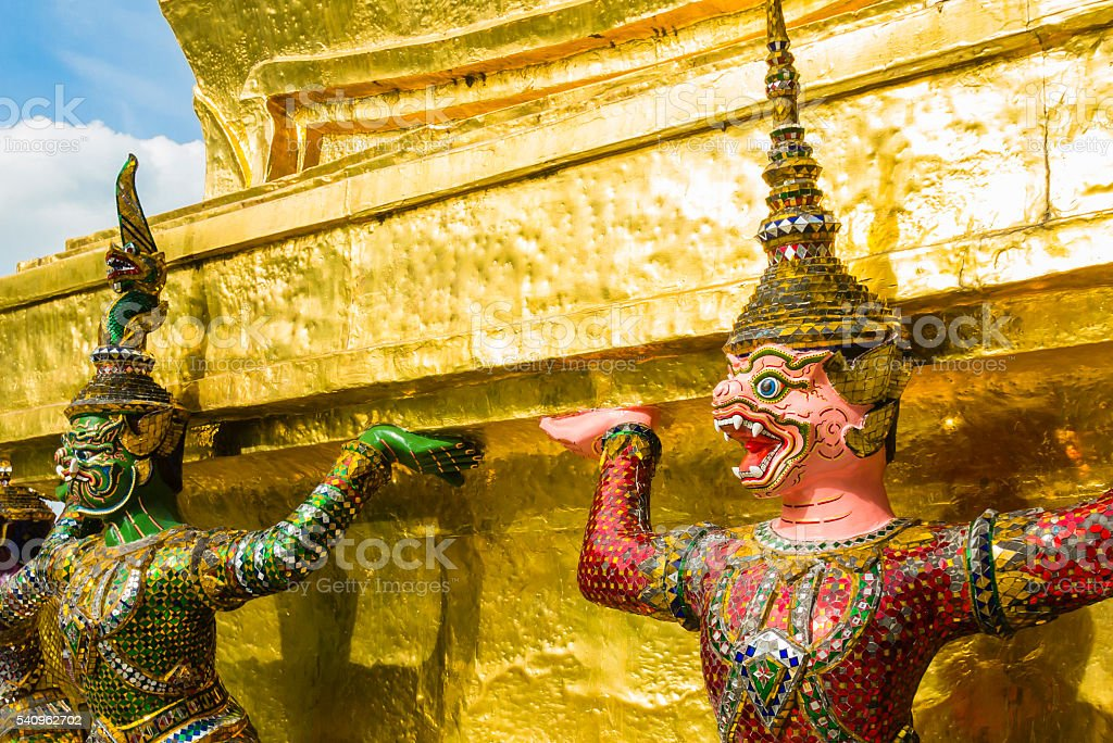 Perspective view of demon guardians supporting Wat Arun Temple, Thailand stock photo