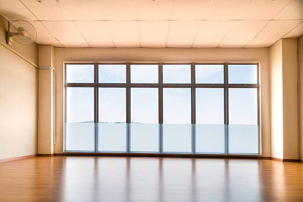 perspective view of empty studio illuminated with light from win - dance class stock photos and pictures