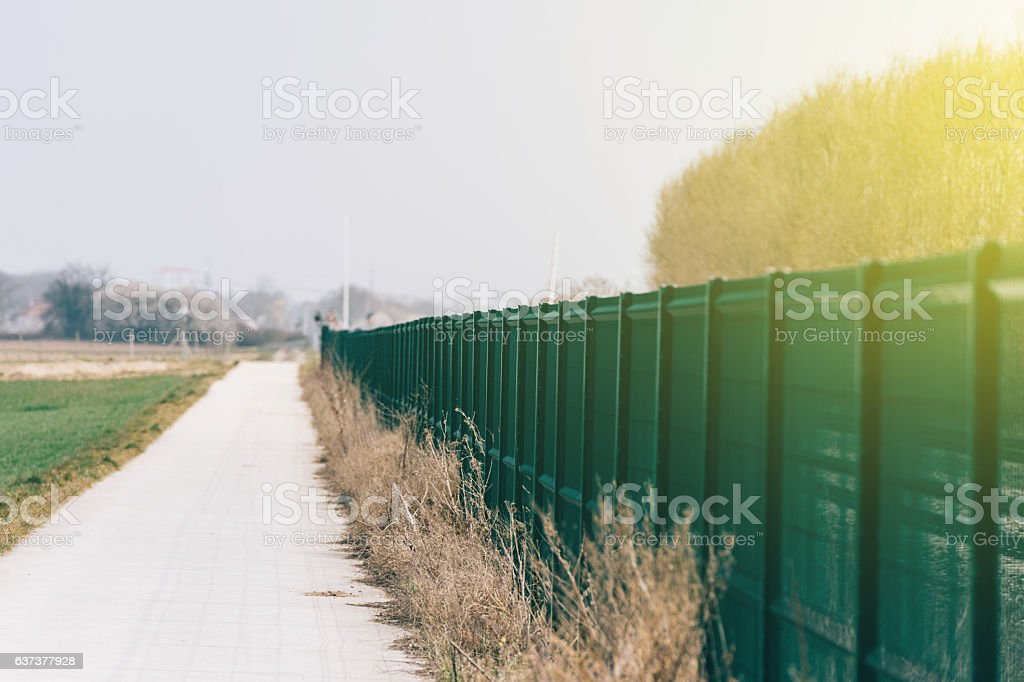 Perspective view of green matallic fence stock photo
