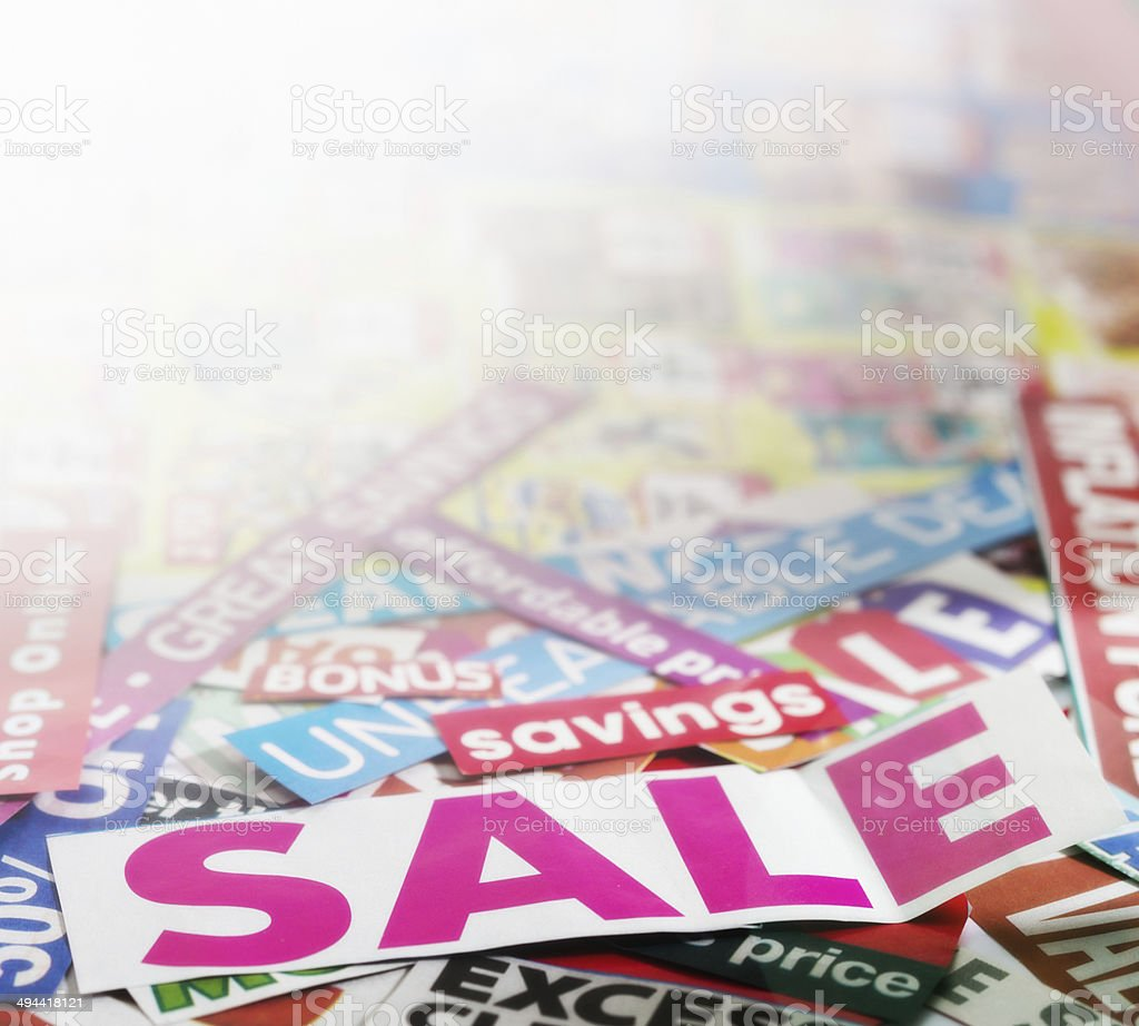 Perspective view of many newspaper cuttings on savings and sales stock photo