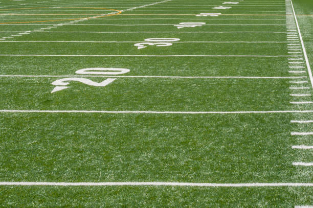 perspective view of marker lines down empty football field perspective view of marker lines down empty football field american football field stock pictures, royalty-free photos & images