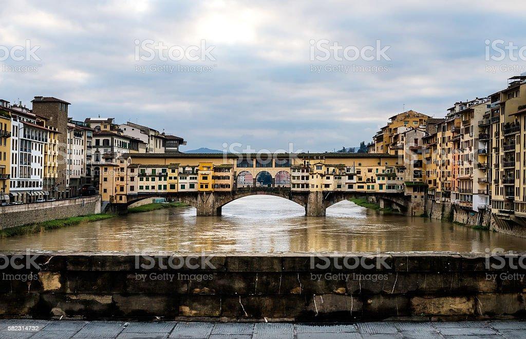 Perspective view of Old Ponte Vecchio Bridge on dull day stock photo