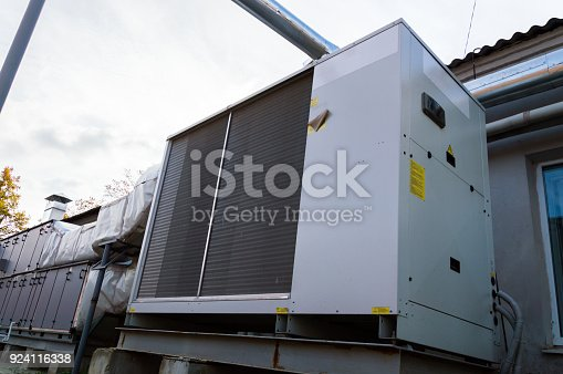 istock Perspective view of the gray commercial cooling unit for central ventilation system 924116338