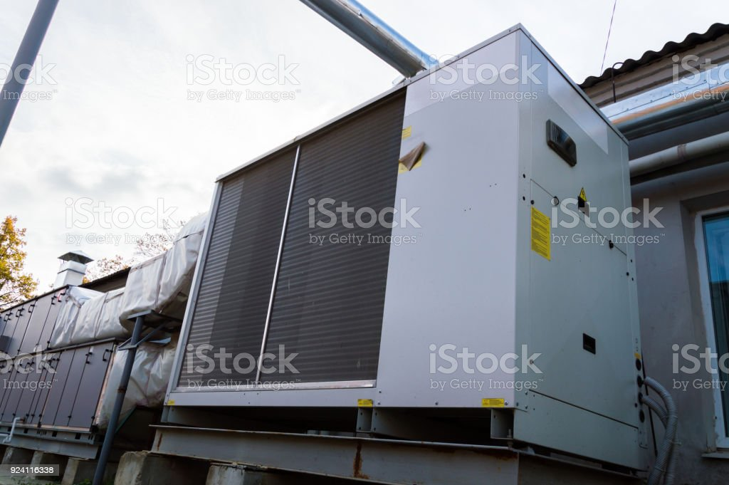 Perspective view of the gray commercial cooling unit for central ventilation system stock photo