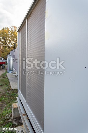 istock Perspective view of the gray commercial cooling unit for central ventilation system 924118236