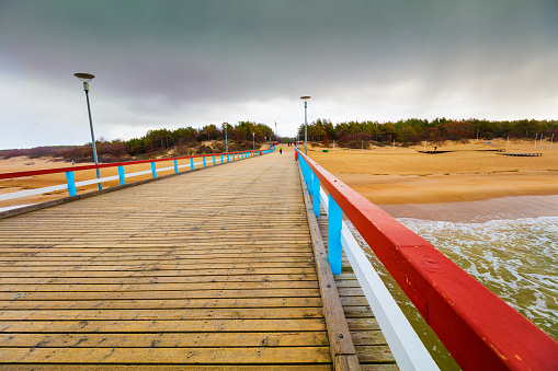 Perspective view of wooden pier over sea