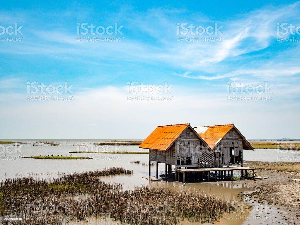 Perspective vintage local traditional old moldy hut in lake stock photo