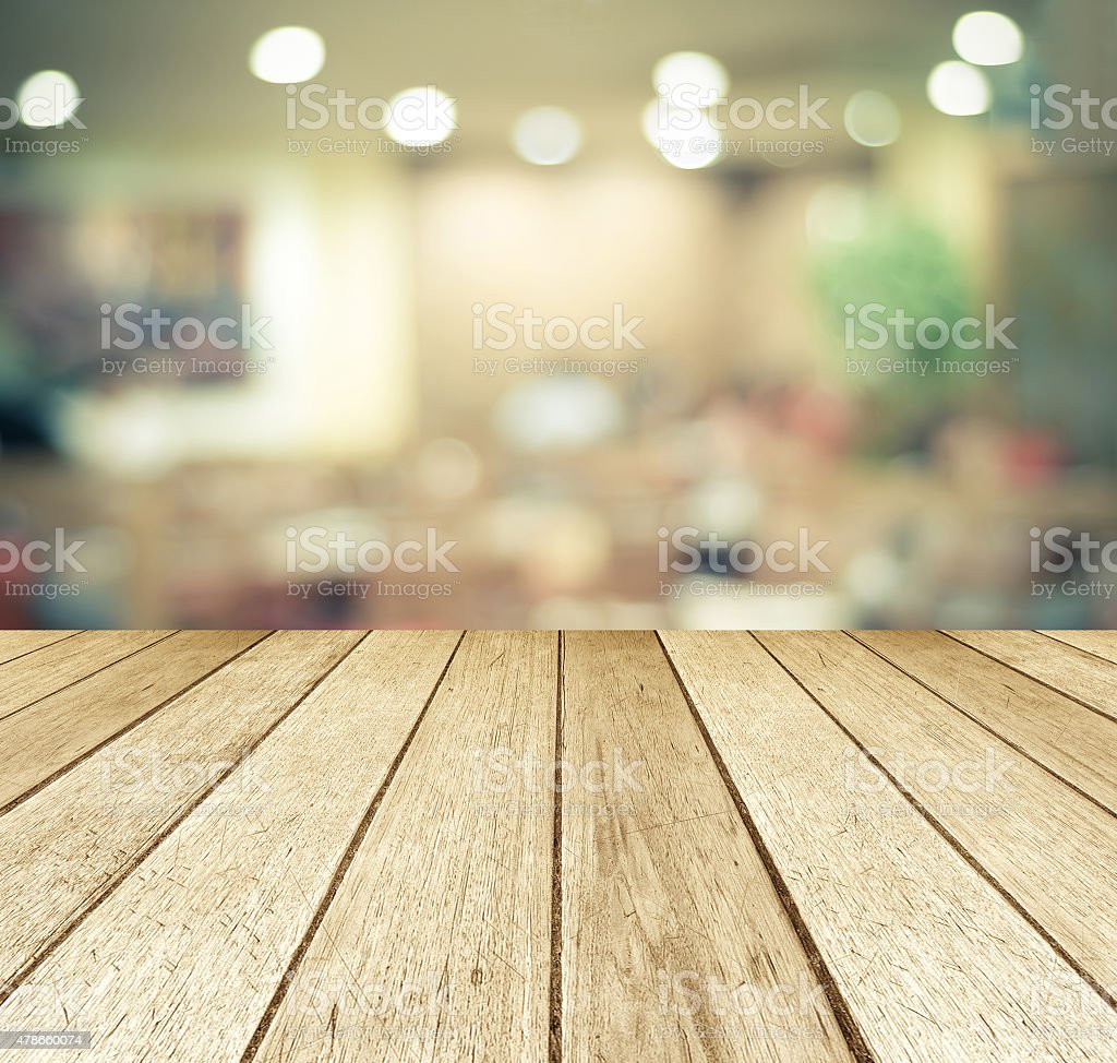 Perspective wood over blurred restaurant with bokeh background stock photo