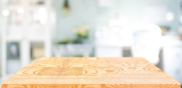 Perspective wood table counter in home office.Empty wooden tabletop with blurred workplace background.Mock up template for display or montage of your design,Banner for advertise of product stock photo