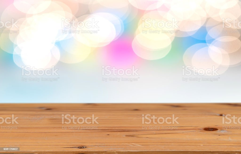 Perspective wooden table for product display montage and abstract lights as background stock photo