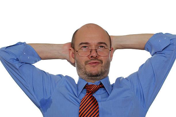 Perspiring Bald Businessman with Job Satisfaction stock photo