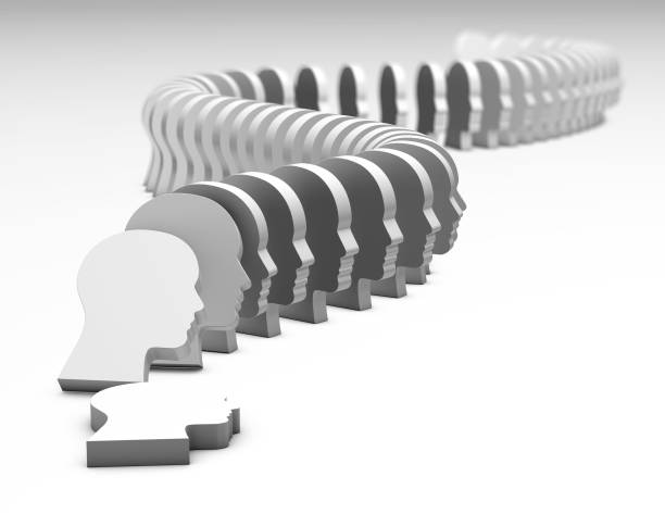 Persuasion concept, domino effect with human faces collapsing 3D illustration. stock photo