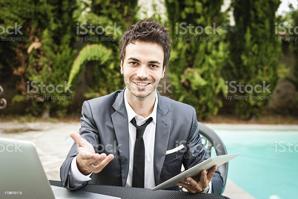 Persuasive businessman offers you something royalty-free stock photo