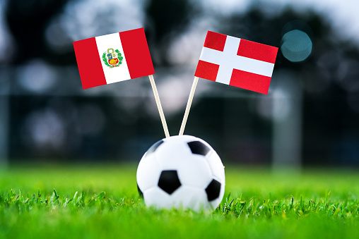 Peru - Denmark, Group C, Saturday, 16. June, Football, World Cup, Russia 2018, National Flags on green grass, white football ball on ground.