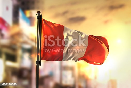 istock Peru Flag Against City Blurred Background At Sunrise Backlight 686178858