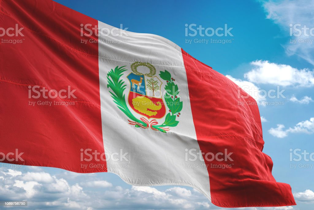 Peru flag waving cloudy sky background stock photo