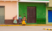 istock Peru: Quechua Women Chatting at Colorful Wall 1337146519