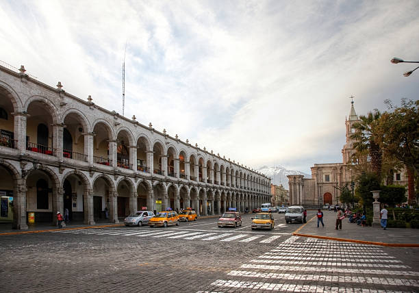 peruvian arcade surrounding town square - peruvian ethnicity stock pictures, royalty-free photos & images