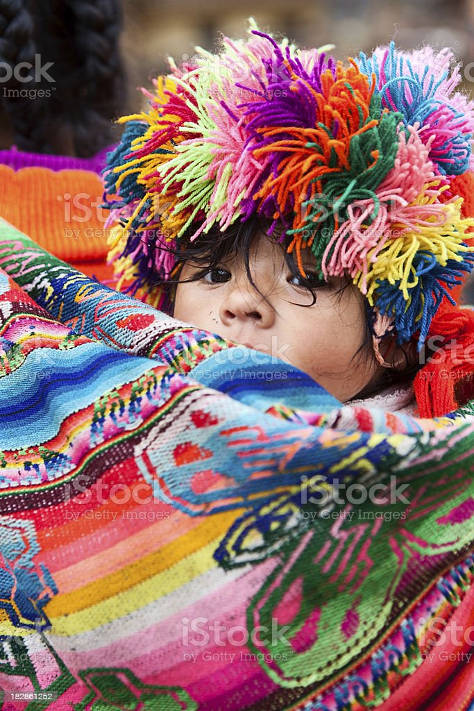 Peruvian baby carrying by its mother, Ollantaytambo stock photo