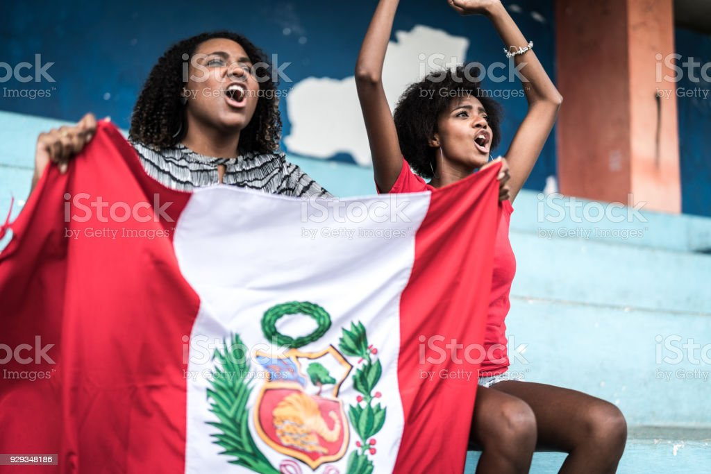 Peruvian fans watching a soccer game stock photo